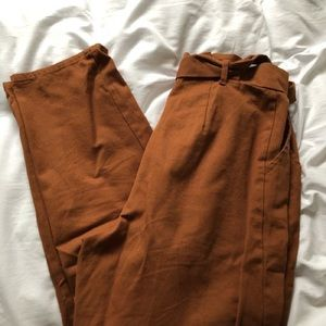 burnt orange paper bag pants!